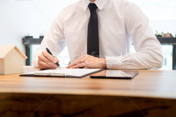 customer signing contract, agreed terms and approved application Stock photo © snowing