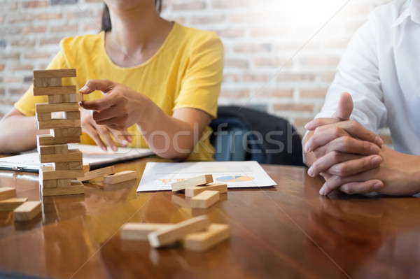 Stock photo: Group of business creative people building tower by wooden block