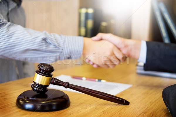 Gavel Justice hammer on wooden table with judge and client shaki Stock photo © snowing