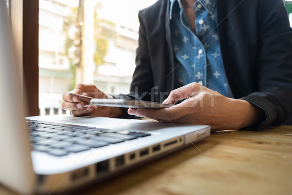 Stock photo: Cropped image of woman inputting card information and key on pho