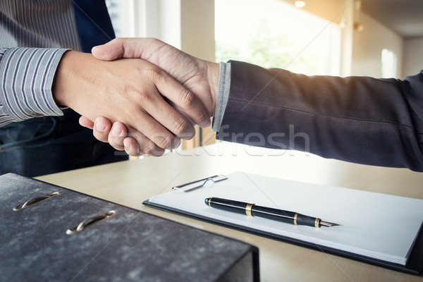 Midsection of a businessman shaking hands with a cropped female  Stock photo © snowing