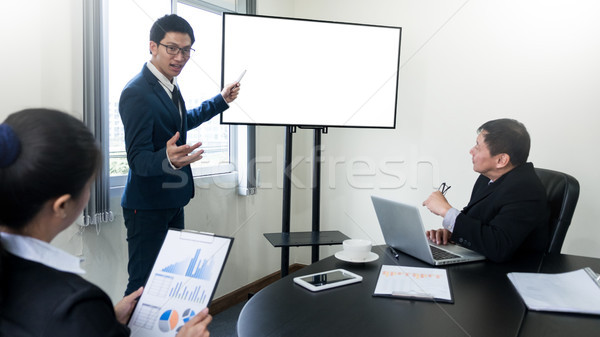 young business man working presentation using television compute Stock photo © snowing