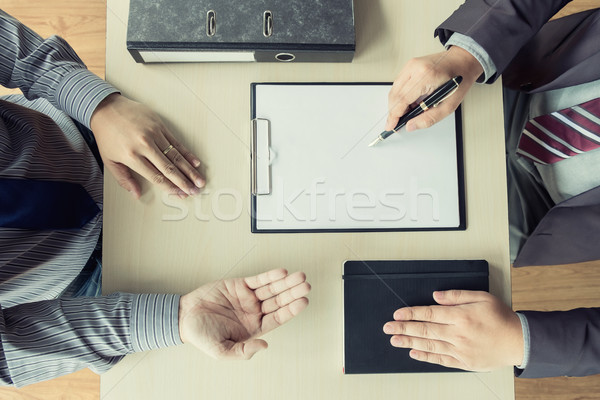 top view of Businessman conducting an interview with businessman Stock photo © snowing