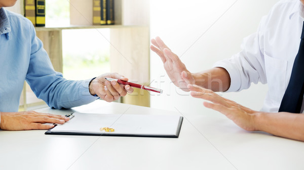 Closeup of a man do not want to Signing Contract or premarital a Stock photo © snowing