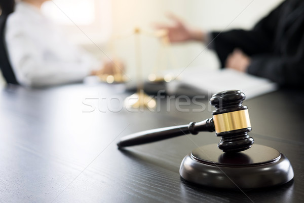 Judge gavel with lawyers advice legal at law firm in background. Stock photo © snowing