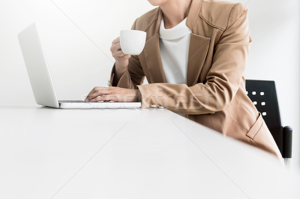 Attractive women in casual business sitting at a table working o Stock photo © snowing