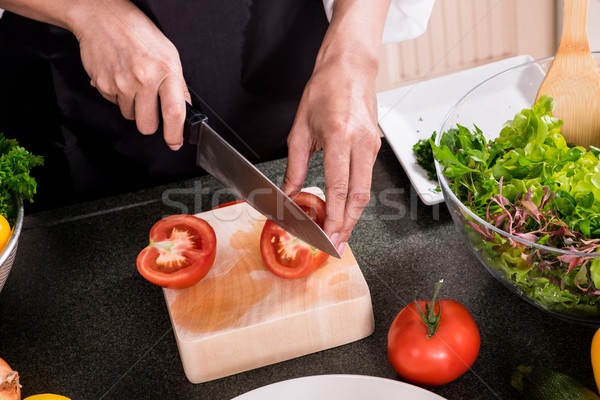 Healthy Woman makes fresh vegetable salad with olive oil, tomato Stock photo © snowing