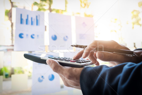 Business finance man calculating budget numbers, Invoices and fi Stock photo © snowing