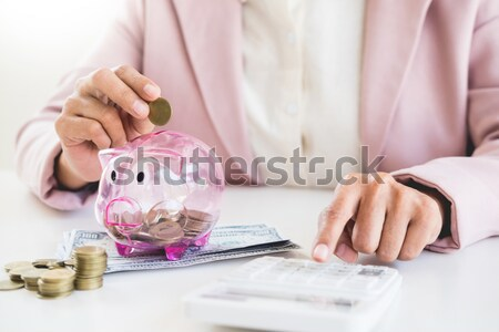 business man counting money at the table, accounting concept. Stock photo © snowing
