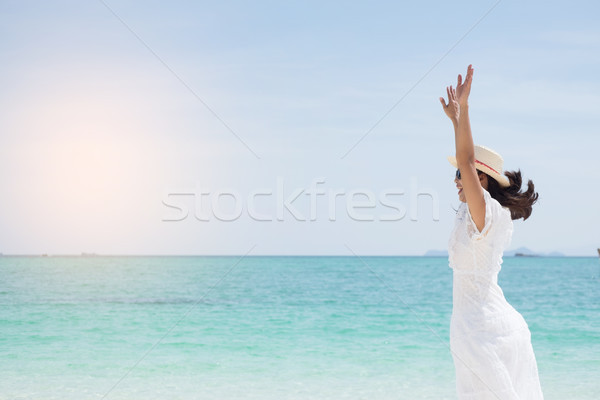 a beautiful carefree Woman relaxing at the beach enjoying her su Stock photo © snowing