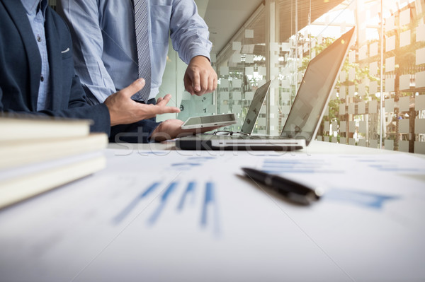 Business adviser analyzing financial figures denoting the progre Stock photo © snowing