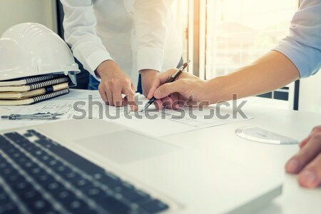 Stock photo: Person's engineer Hand Drawing Plan On Blue Print with architect