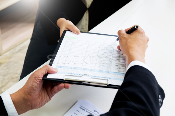Business concept - Executives at desk discussion sales performan Stock photo © snowing