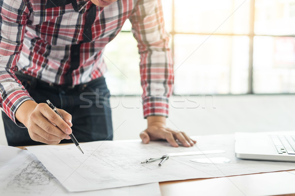 Person's engineer Hand Drawing Plan On Blue Print with architect Stock photo © snowing