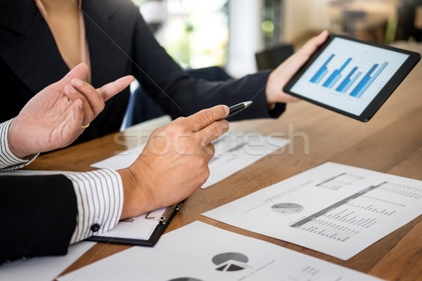 Business man and woman discuss about the financial plan on digit Stock photo © snowing