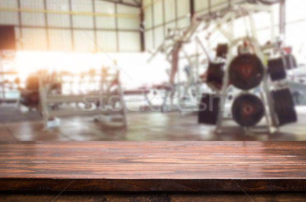 Wooden table on blurred background of fitness gym interior of mo Stock photo © snowing