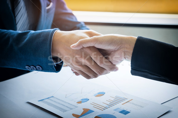 Two businessman shaking hands during a meeting in the office, su Stock photo © snowing