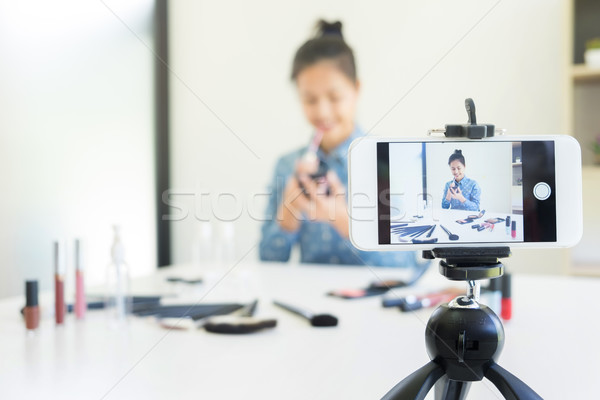 woman present beauty product and broadcast live video to social  Stock photo © snowing