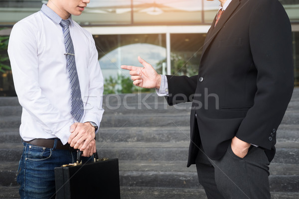 Two confident business partners discussing workflow plan talking Stock photo © snowing