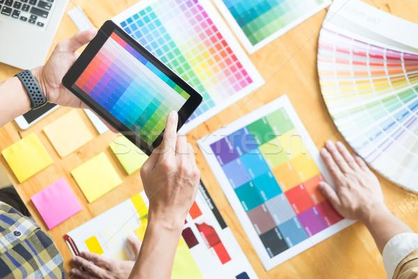 Stock photo: Creative Graphic designer at work. Color swatch samples pantone