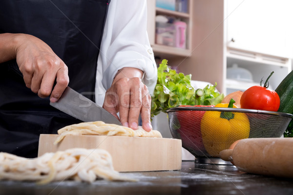 Chef Cutting cook Homemade makes dough fresh Pasta. Stock photo © snowing