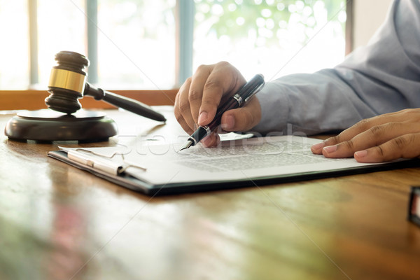 lawyer hand writes the document in court (justice, law) with sou Stock photo © snowing