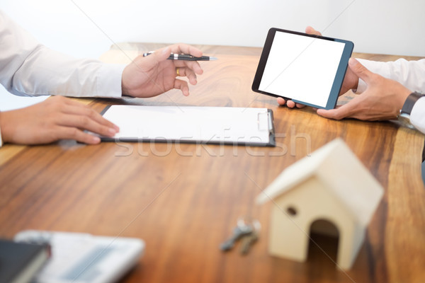 Real estate agent to present the property (house) to customer Stock photo © snowing