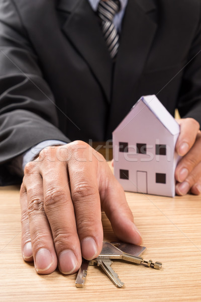 Real estate agent with house model and keys Stock photo © snowing