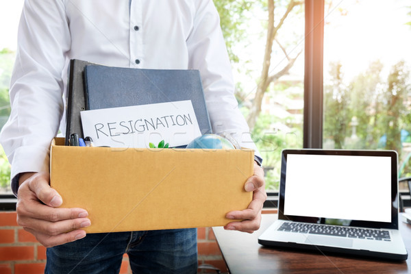 Businessman resignation packing up all his personal belongings a Stock photo © snowing
