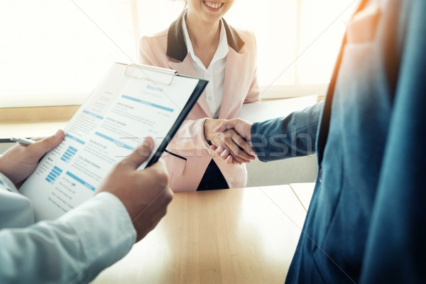 of successful business team shaking hands with eachother in the  Stock photo © snowing