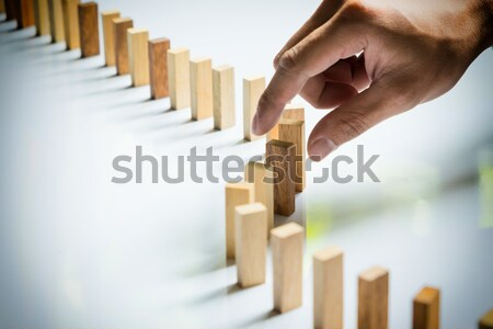 Finger like a business man and wooden block like reached an impa Stock photo © snowing