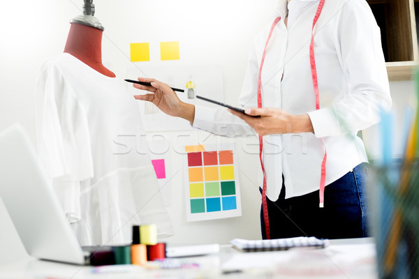 Stylish fashion designer working with measure red dummy as sketc Stock photo © snowing