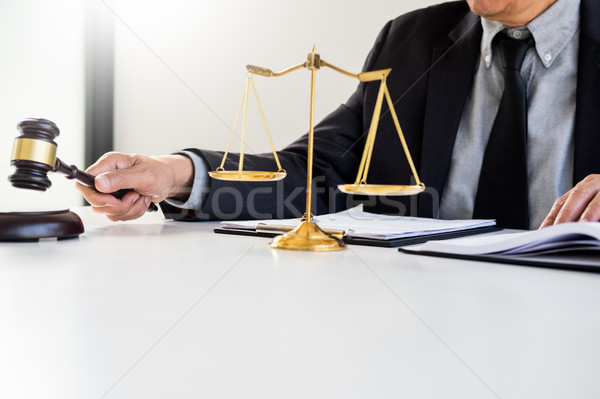 Stock photo: Male Judge lawyer In A Courtroom Striking The Gavel on sounding