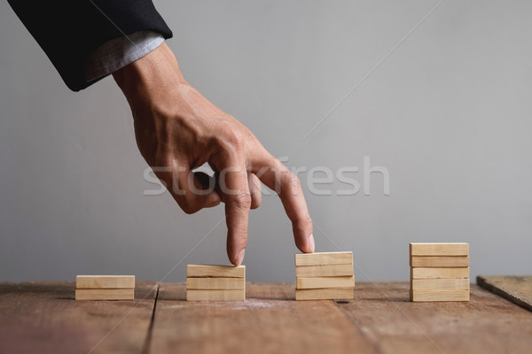 ストックフォト: 手 · 事業者 · ジャンプ · おもちゃ · 階段 · 成功