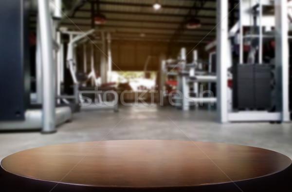 Mesa de madera borroso fitness gimnasio interior moderna Foto stock © snowing