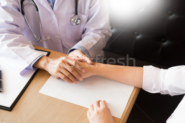 patient listening intently to a male doctor explaining patient s Stock photo © snowing