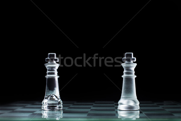 Confrontation - two wooden chess king standing against each othe Stock photo © snowing