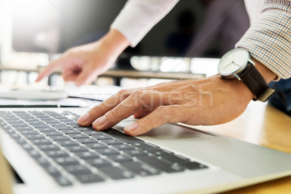 business men working on wooden desk(table) with notebook compute Stock photo © snowing