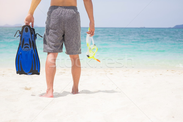 Vacation Backside of man holding snorkeling gear on tropical on  Stock photo © snowing