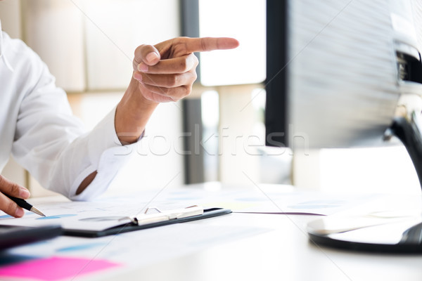businessman working together pointing screen while discussing ex Stock photo © snowing