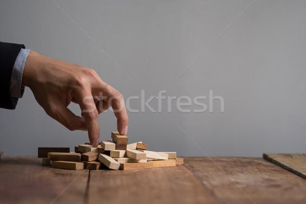 Foto stock: Mão · empresário · para · cima · brinquedo · goa