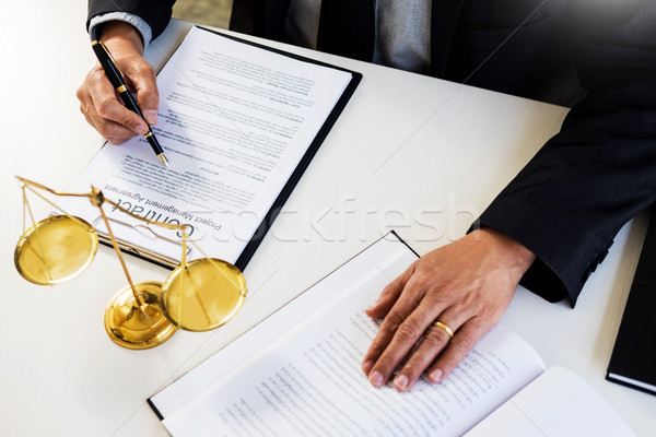 lawyer judge reading writes the document in court at his desk Stock photo © snowing