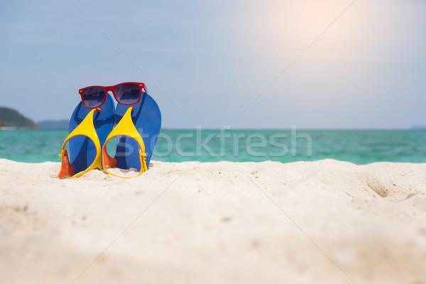 Playa sandalias arenoso mar costa Foto stock © snowing