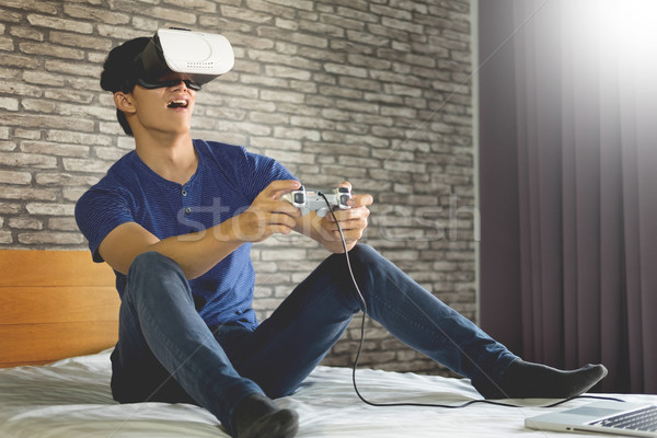 The VR headset design is generic and no logos, Man wearing virtu Stock photo © snowing