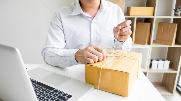Business owner man working online shopping prepare product packa Stock photo © snowing