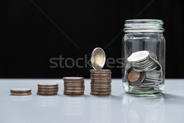 coin piles and glass for investment in the future Stock photo © snowing