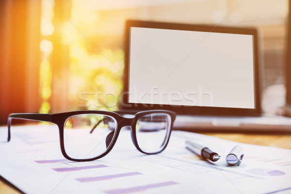 Office workplace with laptop and glasses on wood table Stock photo © snowing