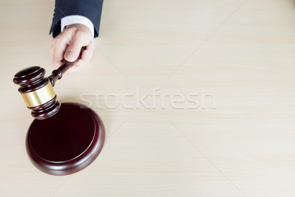 hand of Judge's holding wooden hammer knocking a gavel against w Stock photo © snowing