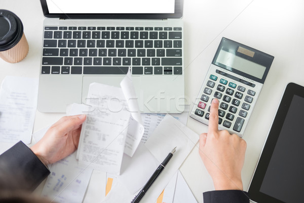 business woman accountant or banker making calculations Bills. d Stock photo © snowing