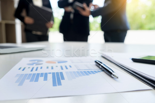 business document in touchpad lying on the desk, office workers  Stock photo © snowing